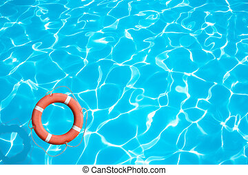 Lifebuoy on blue water surface concept