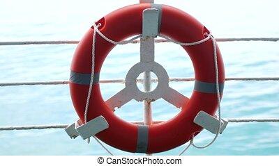 Lifebuoy on ferry, sea travel.