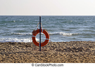 Lifebuoy on the bank of the Black Sea.