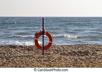 Lifebuoy on the bank of the Black Sea.