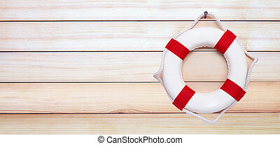 Lifebuoy on wooden background.