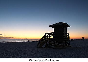 Lifegaurd station on Siesta Key, Florida at sunset
