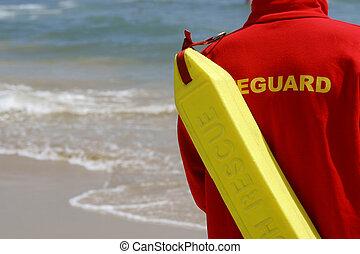 A lifeguard watching a sandy shoreline