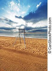 chair on an empty beach