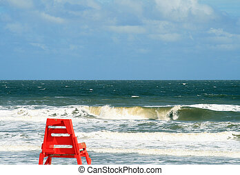 Lifeguard chair against a choppy sea