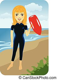 Lifeguard girl carrying a red buoy.