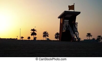 Lifeguard house on the beah at sunset in the Dubai.