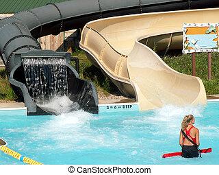 female lifegaurd in pool at water park