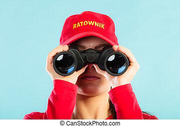 lifeguard on duty looking through binocular - Accident...