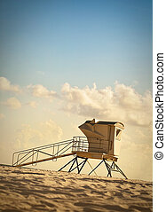 Lifeguard Station at sunset - Vintage toned photo of...