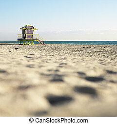 Art deco lifeguard tower on deserted beach in Miami, Florida, USA.