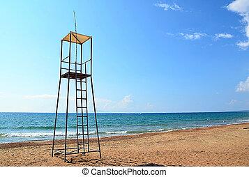 lifeguard tower on the beach near to sea