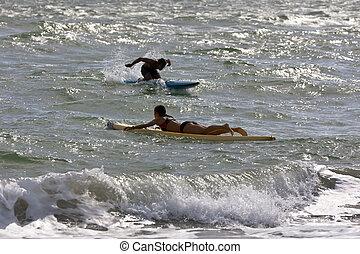 Lifeguards practice their lifesaving skills in the ocean