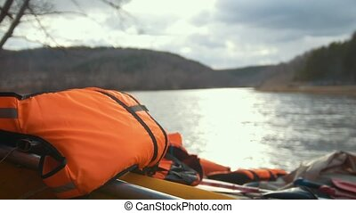 Lifejacket on the inflatable catamaran on the mountain river...