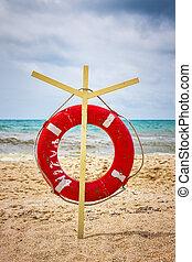 lifeline on the beach - lifeline onn stand on the sea beach,...