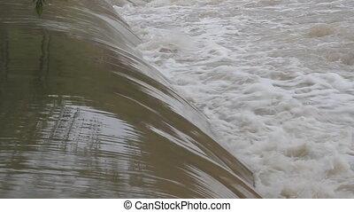 Lifering stuck in river. - Orange lifering stuck in a...