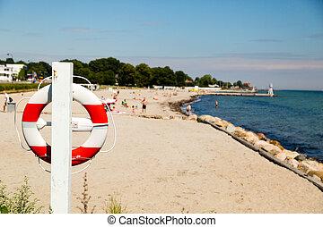 Lifesaving equipment at beach - Life on a sunny summer day...