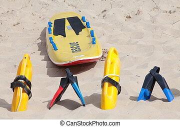 Lifesaving equipment lying on the beach sand