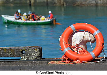 Lifesaving ring buoy on a wharf