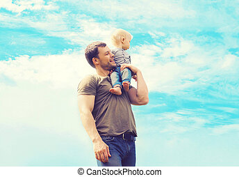 Lifestyle atmospheric photo happy father and son child...