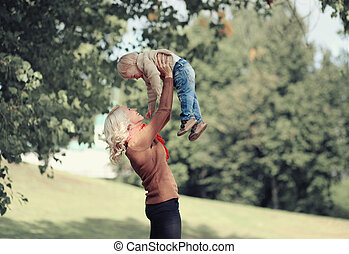 Lifestyle autumn photo happy mother and child having fun togethe