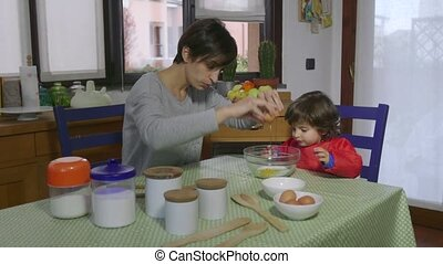 Lifestyle Baby And Woman Cooking - People, family life, fun,...