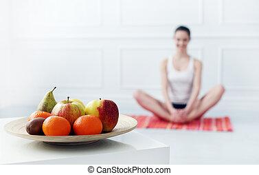Lifestyle. Beautiful girl during yoga exercise