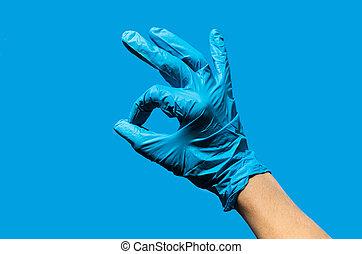 Ok sign made of medical gloves