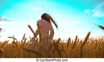 lifestyle girl is walking along the wheat field nature slow...