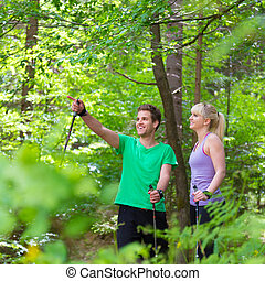 Lifestyle in nature. - Young spoty active cople with hiking ...