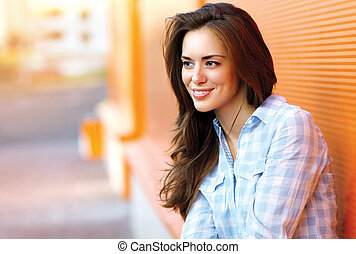Lifestyle portrait happy pretty young woman outdoors in city