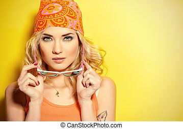 lifestyle - Pretty girl with curly blonde hair wearing ...