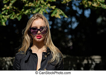 Lifestyle shot of adorable blonde model with reb lips...