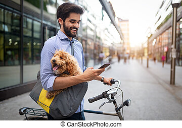 Lifestyle, transport, communication and people concept . Young man with bicycle and smartphone on city street