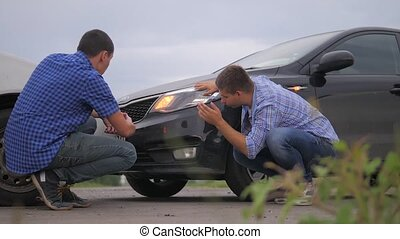 lifestyle Two men arguing conflict after a car accident on...