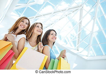 Lifestyles - Smiling girl with shopping bags