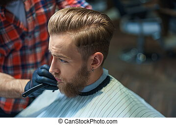 Young man in barber shop
