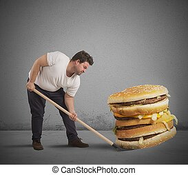 Lift giant sandwich - Man lifts with shovel a giant sandwich
