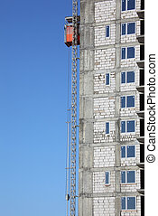 lift on wall of under construction building