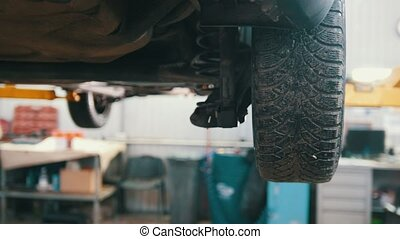 Lifted car elevated in professional service - process...