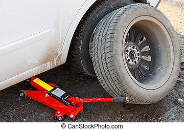 lifting car by hydraulic jack