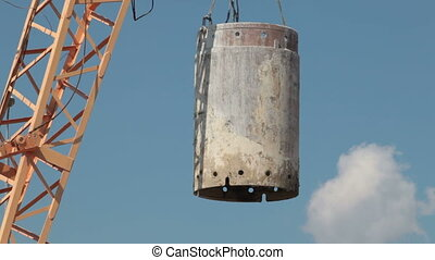 Lifting cargo by crane  at the construction site