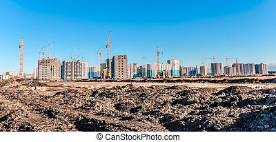 Lifting crane and construction of houses