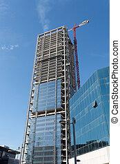 Lifting crane at skyscraper construction site