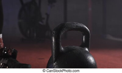 Lifting heavy weights by hand close-up. - Lifting heavy...