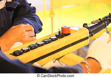 Lifting remote on hand worker