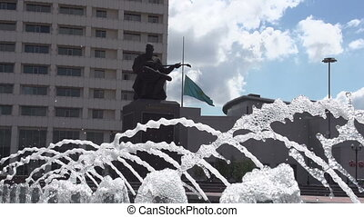 Lifting the State Flag - Jet fountain in the background of...