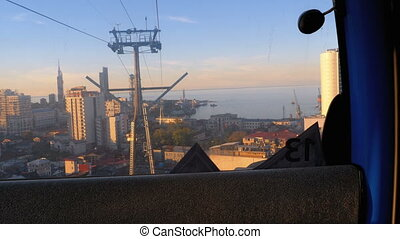 Lifting up the cable car in Batumi. View from the cabin on...