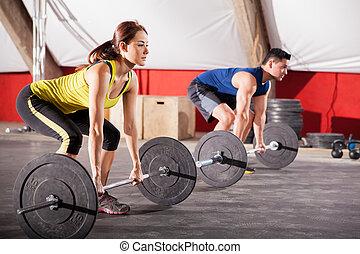 Lifting weights at a gym