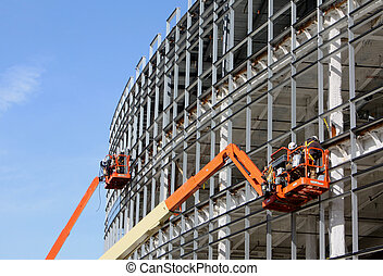 Lifts at a new construction site - Lifts for workers on ...